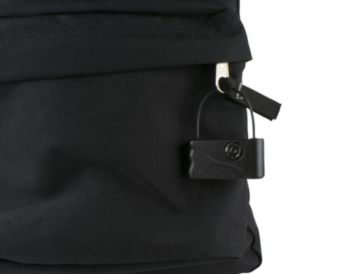 Black security lanyard tag attached to a backpack