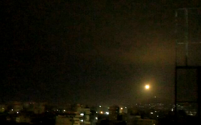 Syrian anti-aircraft missile is fired into the night sky near Damascus during an Israeli airstrike on Iranian and Hezbollah targets on January 6, 2021 (Screen capture: SANA)
