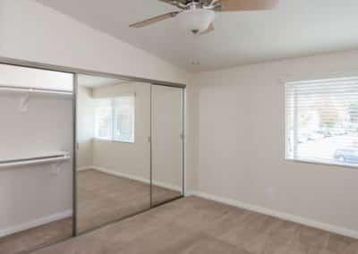 Empty bedroom with big windows and closet