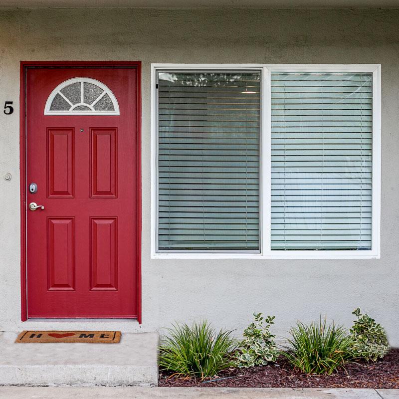 Entrance of Park Del Amo apartment unit with a red door