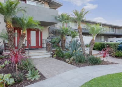 Entrance with green plants at Park Del Amo Apartment Homes