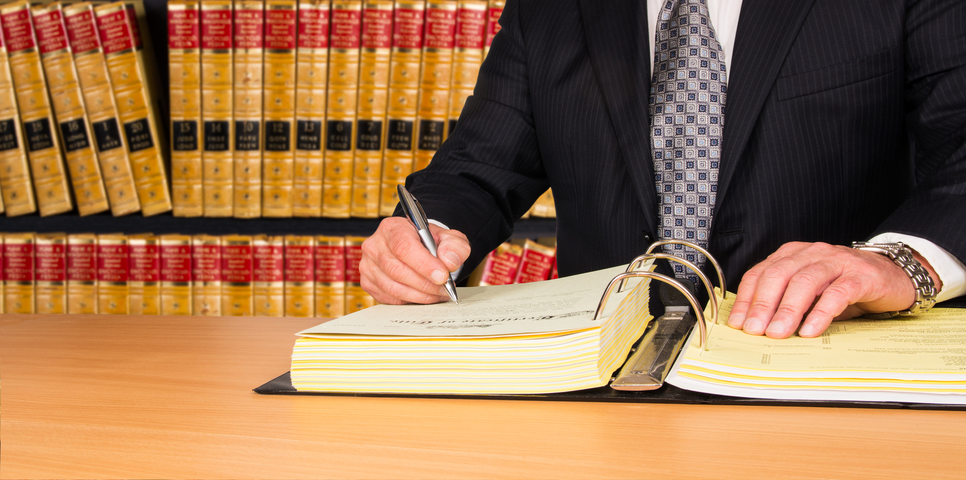 Lawyer signing legal documents