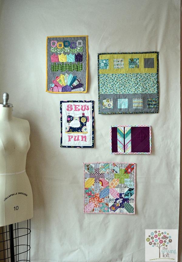 Wall of mini quilts in progress. The Sewing Loft