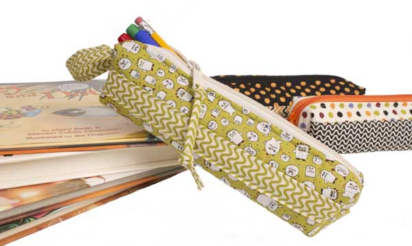 Annie joins the fun of National Sewing Month and shows us how to turn leftover fabric bits into a one of a kinda scrappy pencil case for everyday use. The Sewing Loft