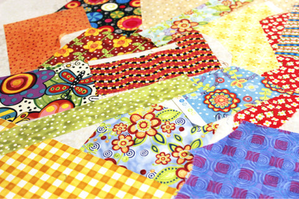 Scraps use in the scrappy trim pillow project. The Sewing Loft