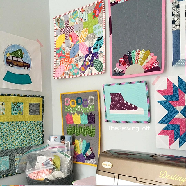 Sewing Corner of The Sewing Loft. Love the way the wall of mini quilts is coming together.