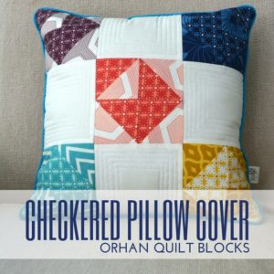 Put extra quilt blocks to use with this simple checkered pillow pattern cover.
