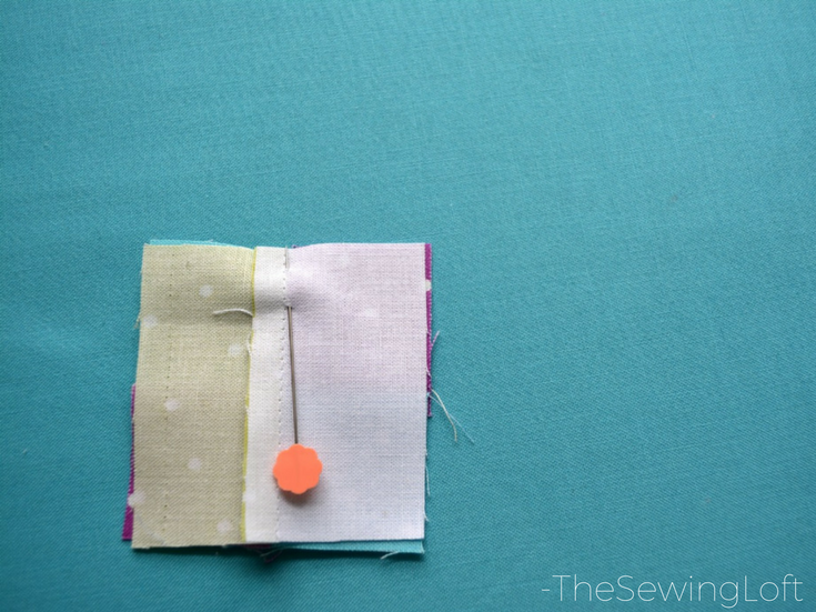 Use flat head pins to line seams up for easy stitching.