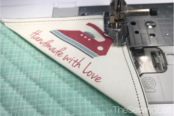 Don't forget to add a label to your sewing project before attaching the quilt binding.