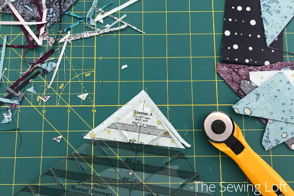Cutting half square triangles is a breeze with the Clearly Perfect Slotted Ruler.