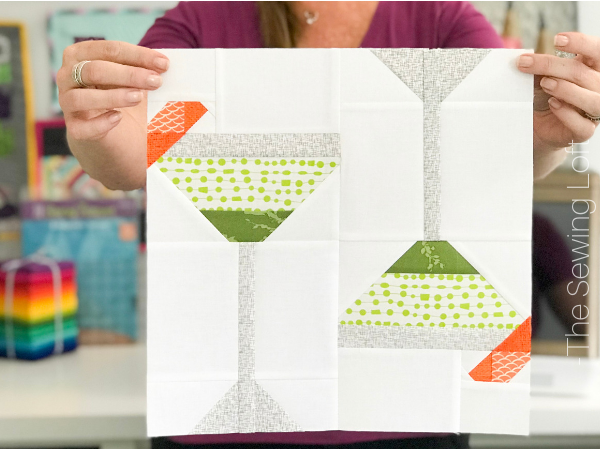 """Grow your quilting skills with this fun Cocktail Hour quilt block. The easy to make, patchwork construction block finishes 12"""" square."""