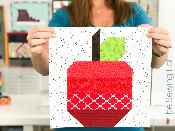 Learn quilting basics while creating whimsical quilt blocks like the Apple Quilt block in the Blocks 2 Quilt series.