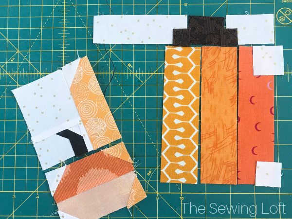 The simple patchwork construction of the Pretty Pumpkins quilt block makes it perfect for for quilters to play with their scraps.
