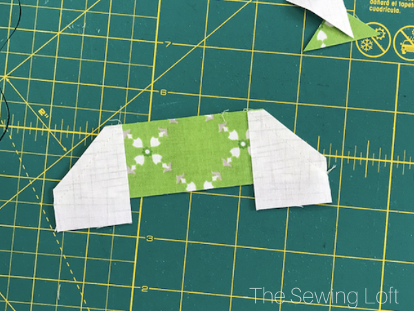 Are you ready to start stitching for the holidays? It's easy to make, scrap friendly Christmas Tree Quilt Pattern available in 2 sizes from The Sewing Loft
