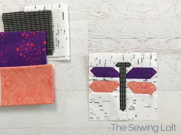 Pretty fabric scraps pulled to stitch up the Dragonfly quilt block pattern by The Sewing Loft
