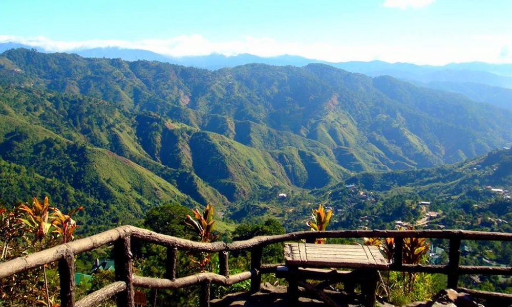 Mines View Park in Baguio, Philippines. View from a mountain top - valleys and green pastures