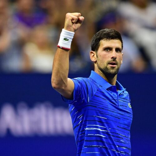 Novak Djokovic with his right hand fist held high