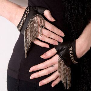 Cropped fingerless lambskin leather gloves with stainless steel chain on wrist and chain fringe trim.