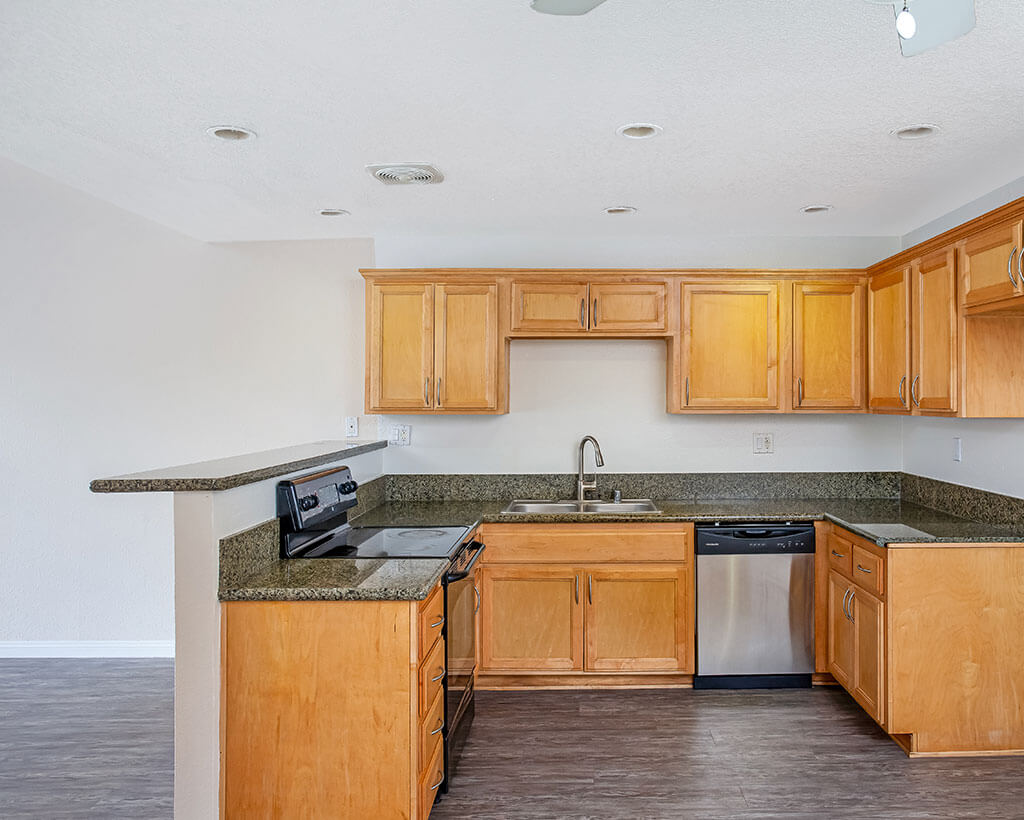 Kitchen with quartz counters, maple cabinets, and stainless steel appliances