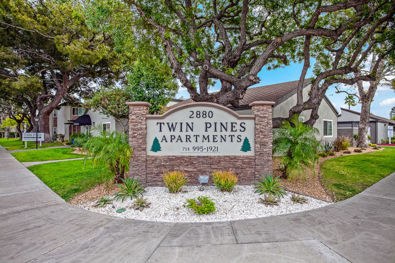 Twin Pines Apartment Homes sign