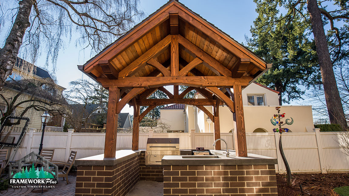 A grill pit with a custom pavilion designed by Framework Plus in Estacada, OR