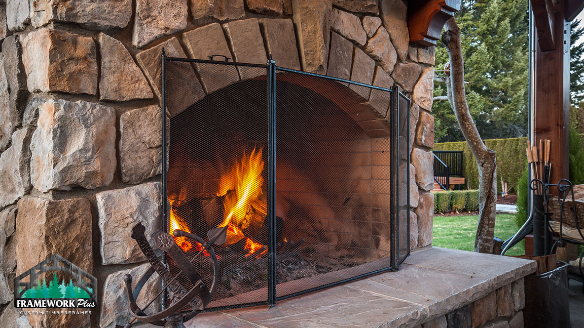 Close-up of fireplace inside of the MT. Hood Timber Frame Pavilion built by timber pavilion kits provider Framework Plus in Portland, OR