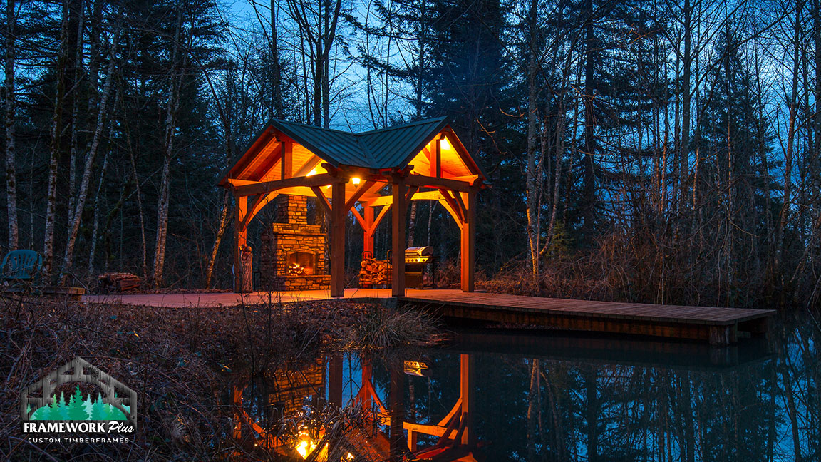 A pavilion with a fireplace crafted by Framework Plus in Portland, OR