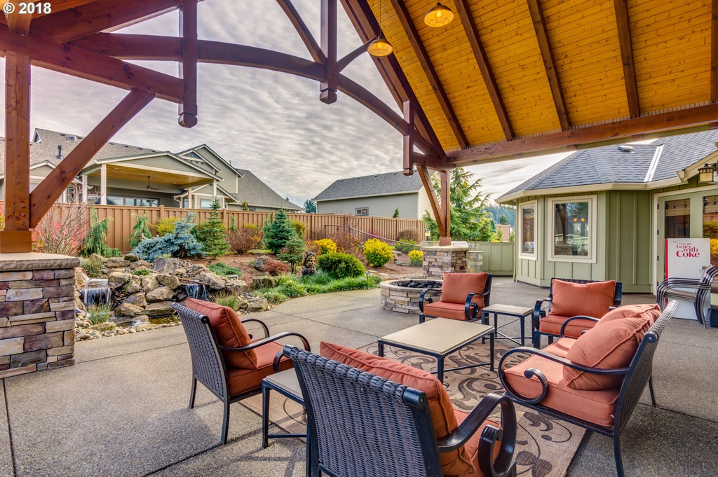 Inside view of custom outdoor patio designed by timber pavilion kit company Framework Plus in Estacada, OR