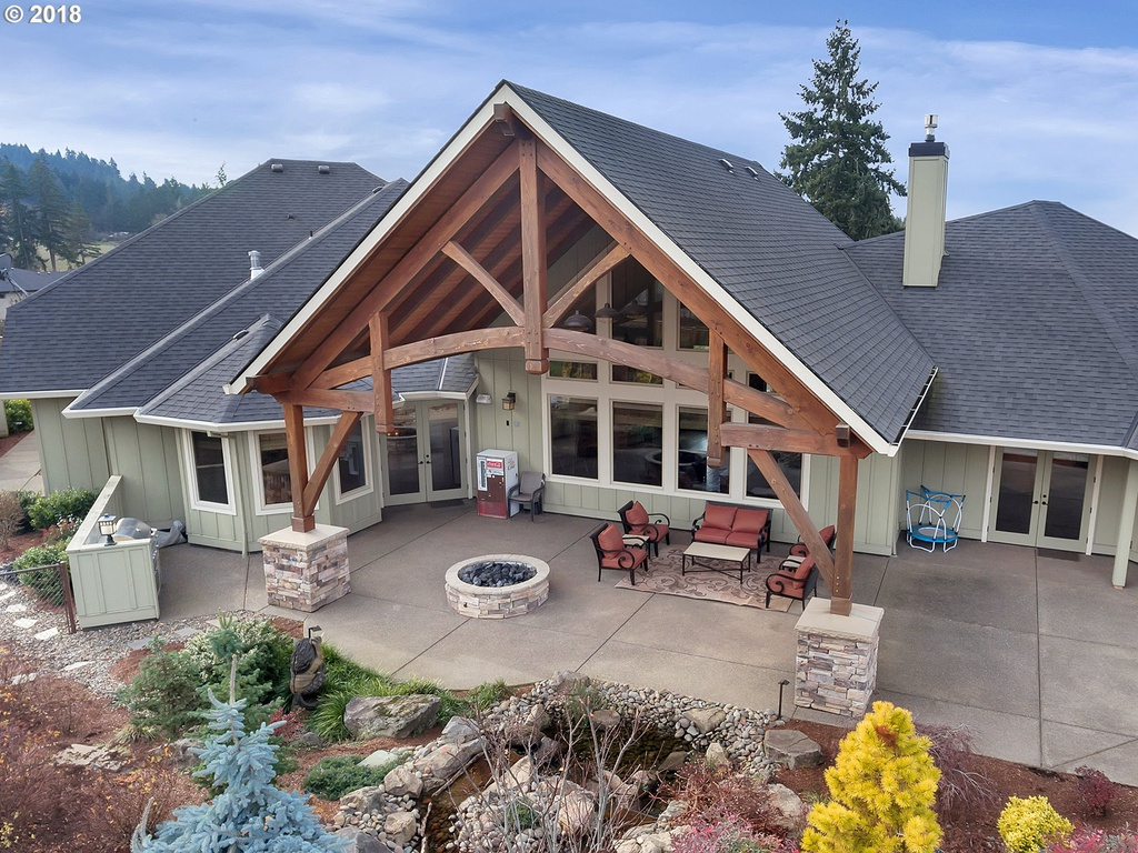 Outside daytime view of custom outdoor patio designed by timber pavilion kit company Framework Plus in Estacada, OR