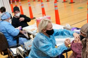 VA Expands Vaccination to Some Non-Health Care Staff as Postal Workers Face Uncertainty