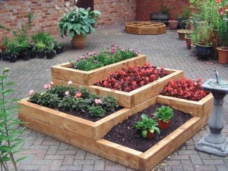 6 Spectacular Raised Bed Design Ideas for Spring - Lifescape ... on veggie garden design ideas, butterfly garden design ideas, rain garden design ideas, landscape garden design ideas, tree design ideas, permaculture design ideas, vertical garden design ideas, lawn care design ideas, community garden design ideas, mulch design ideas, vegetable design ideas, kitchen design ideas, home garden design ideas, water design ideas, herb gardens design ideas, edible landscaping design ideas, horticulture design ideas, plant nursery design ideas, recycling design ideas, terrarium design ideas,