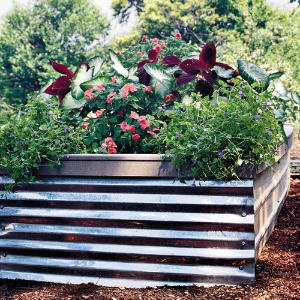 6 Spectacular Raised Bed Design Ideas for Spring - Lifescape ... on tree design ideas, home garden design ideas, horticulture design ideas, landscape garden design ideas, butterfly garden design ideas, edible landscaping design ideas, terrarium design ideas, permaculture design ideas, plant nursery design ideas, veggie garden design ideas, rain garden design ideas, vegetable design ideas, kitchen design ideas, mulch design ideas, recycling design ideas, herb gardens design ideas, vertical garden design ideas, water design ideas, community garden design ideas, lawn care design ideas,