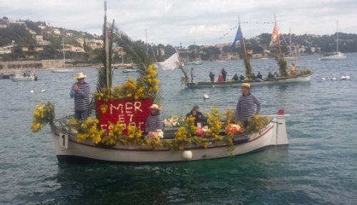 The Villefranche-sur-mer Naval Flower Battle features up to 20 local fishing boats decked out in elaborate flower arrangements