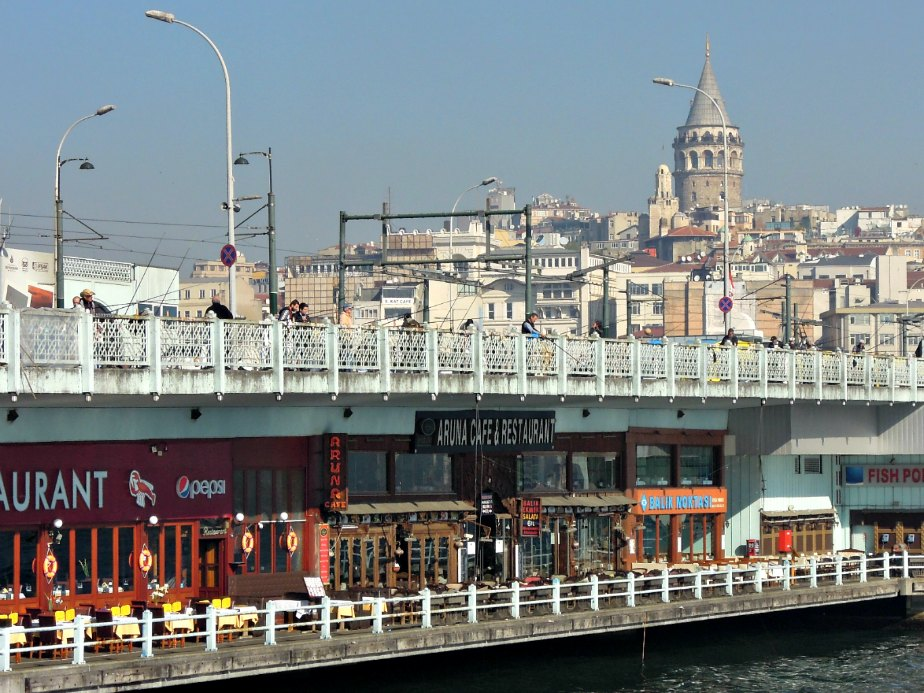Galata Tower Looks Over the Bridge