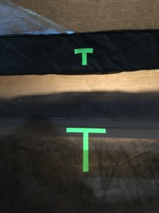 A T shaped marking on both a show scrim and dance floor, showing center