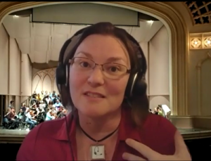 A woman with a headset microphone