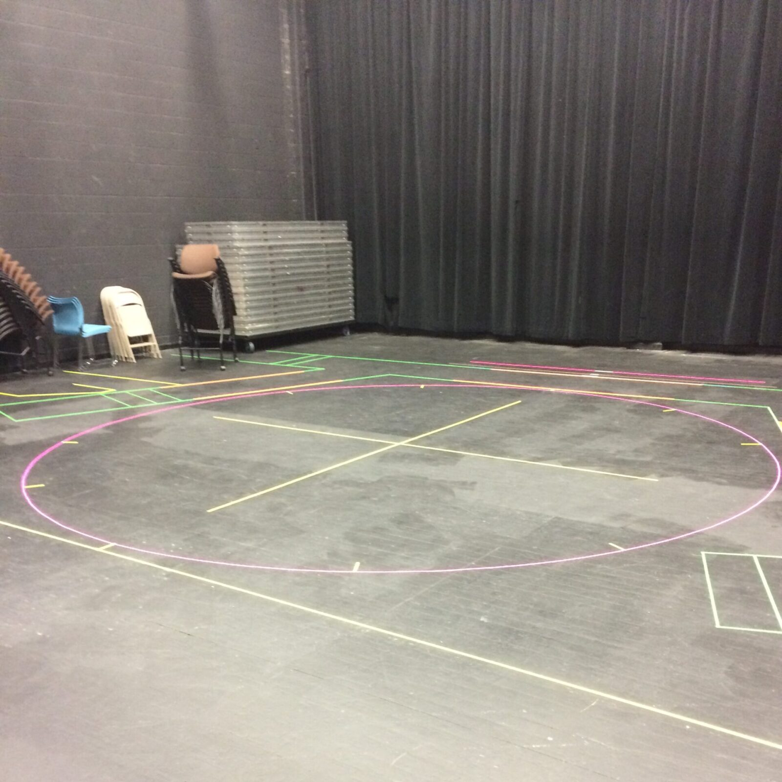 Photo of a completed groundplan of spike tape in a rehearsal hall