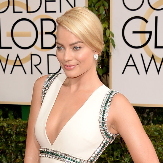 Margot Robbie stuns in simple makeup and a timeless chignon.