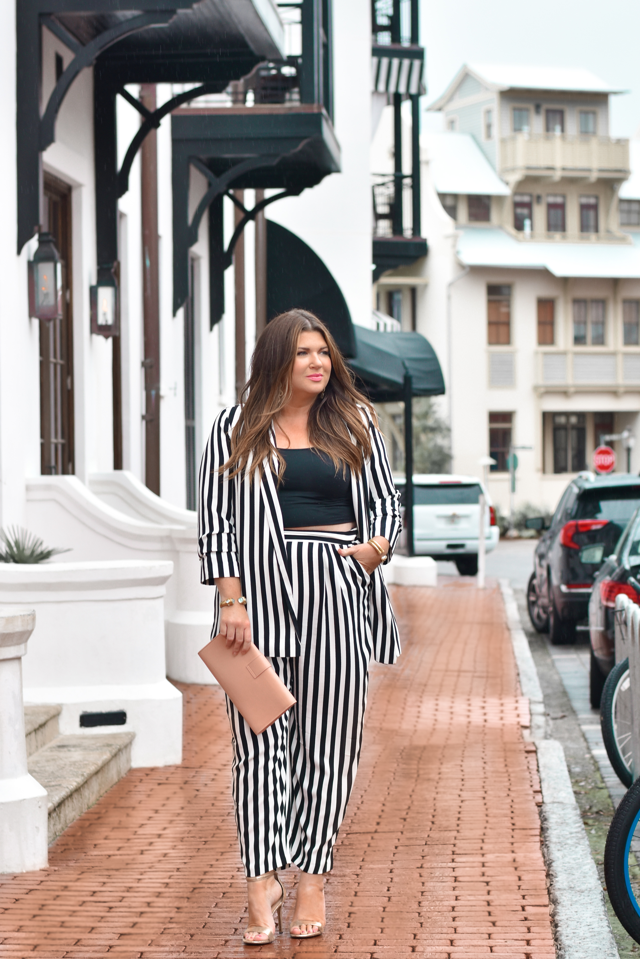 30A Style - Jami Ray wearing a stripe suit in Rosemary Beach