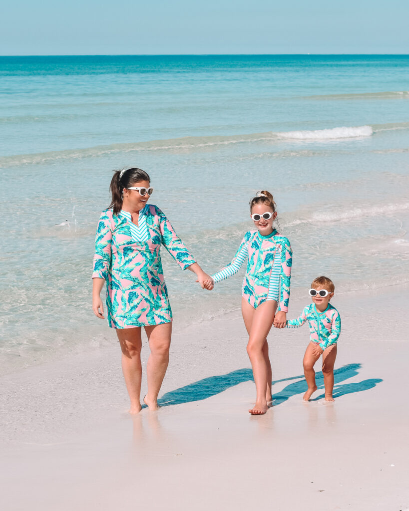 30A Mama wearing Shade Critters swimsuits