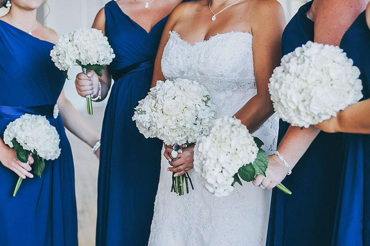 white and purple wedding bouquet with fresh greenery