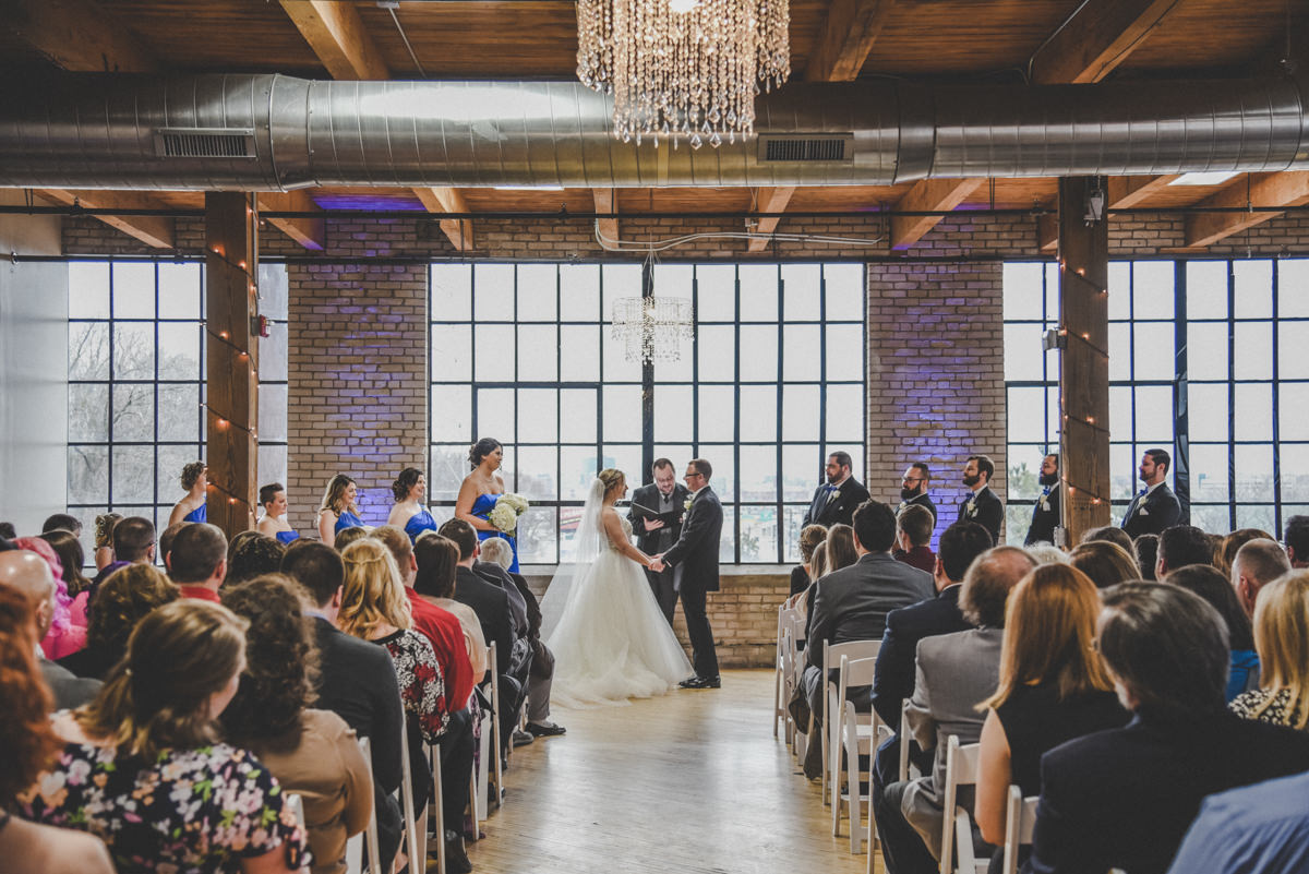 an image of the entire bridal party and guests during a wedding ceremony