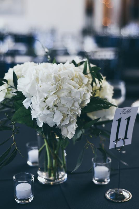 fresh white hydrangea centerpieces at a wedding reception