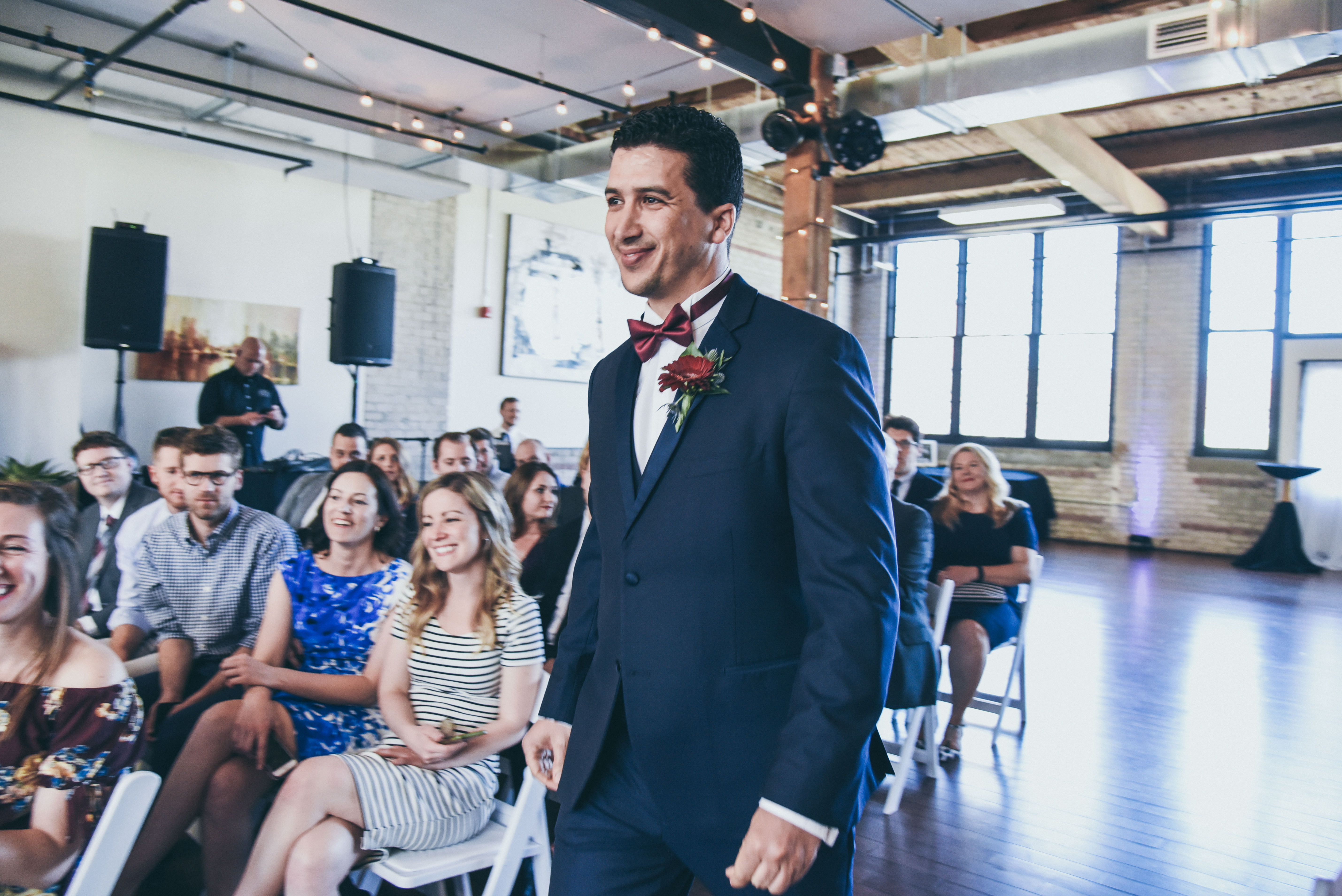 A groom walking down the aisle at his wedding