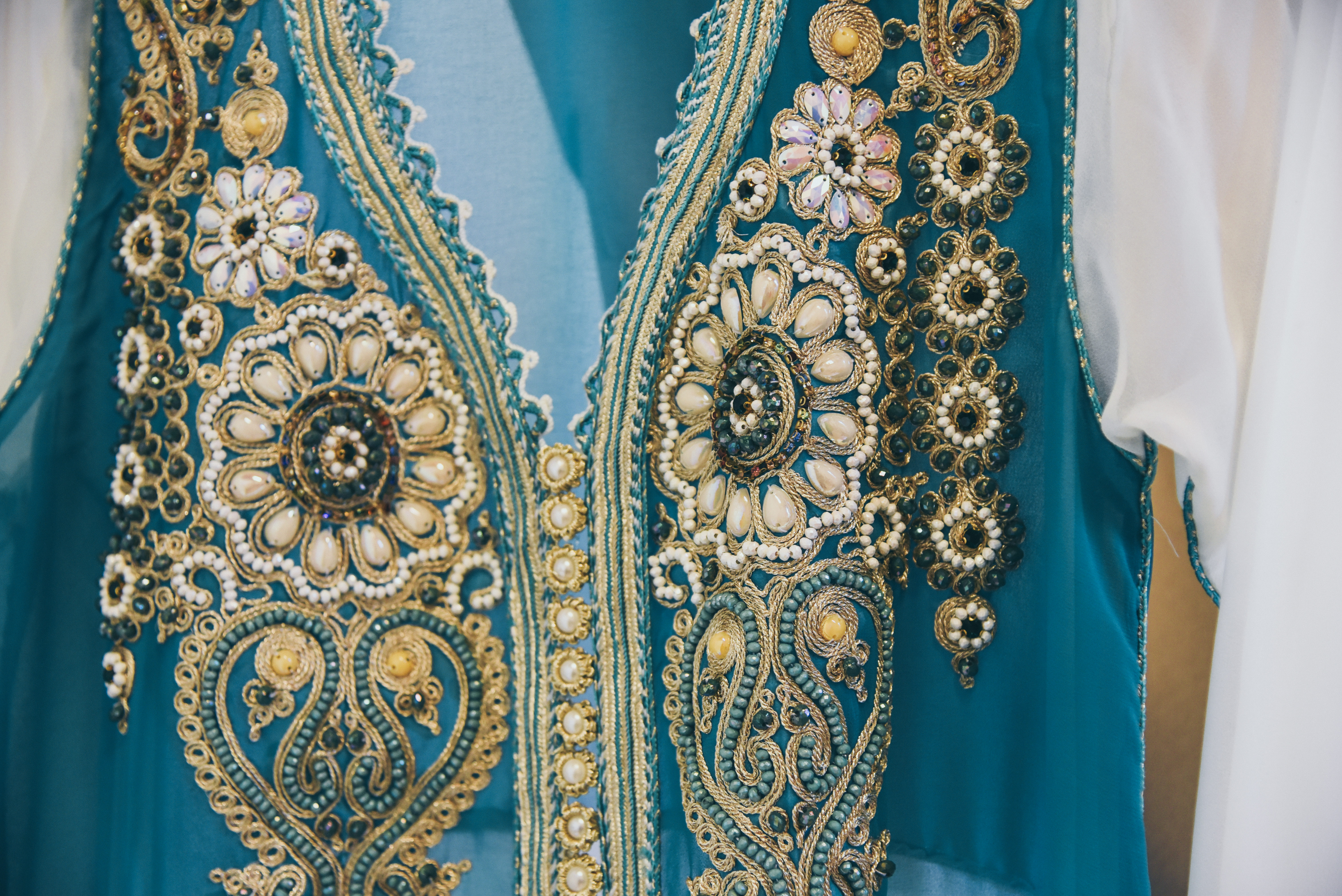 groom's moroccan wedding outfit in teal and gold
