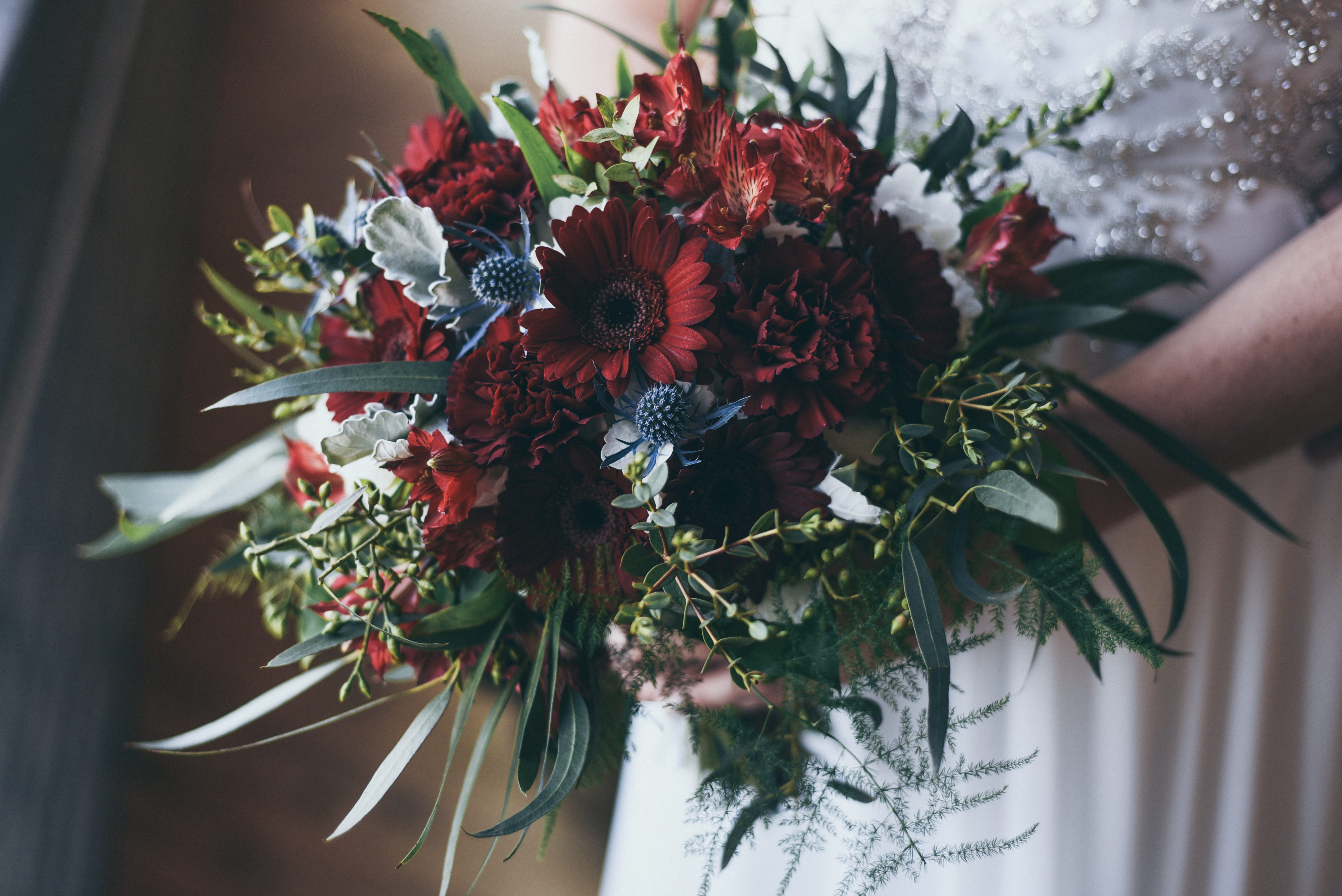 bridal bouquet of navy, burgundy, white and greens