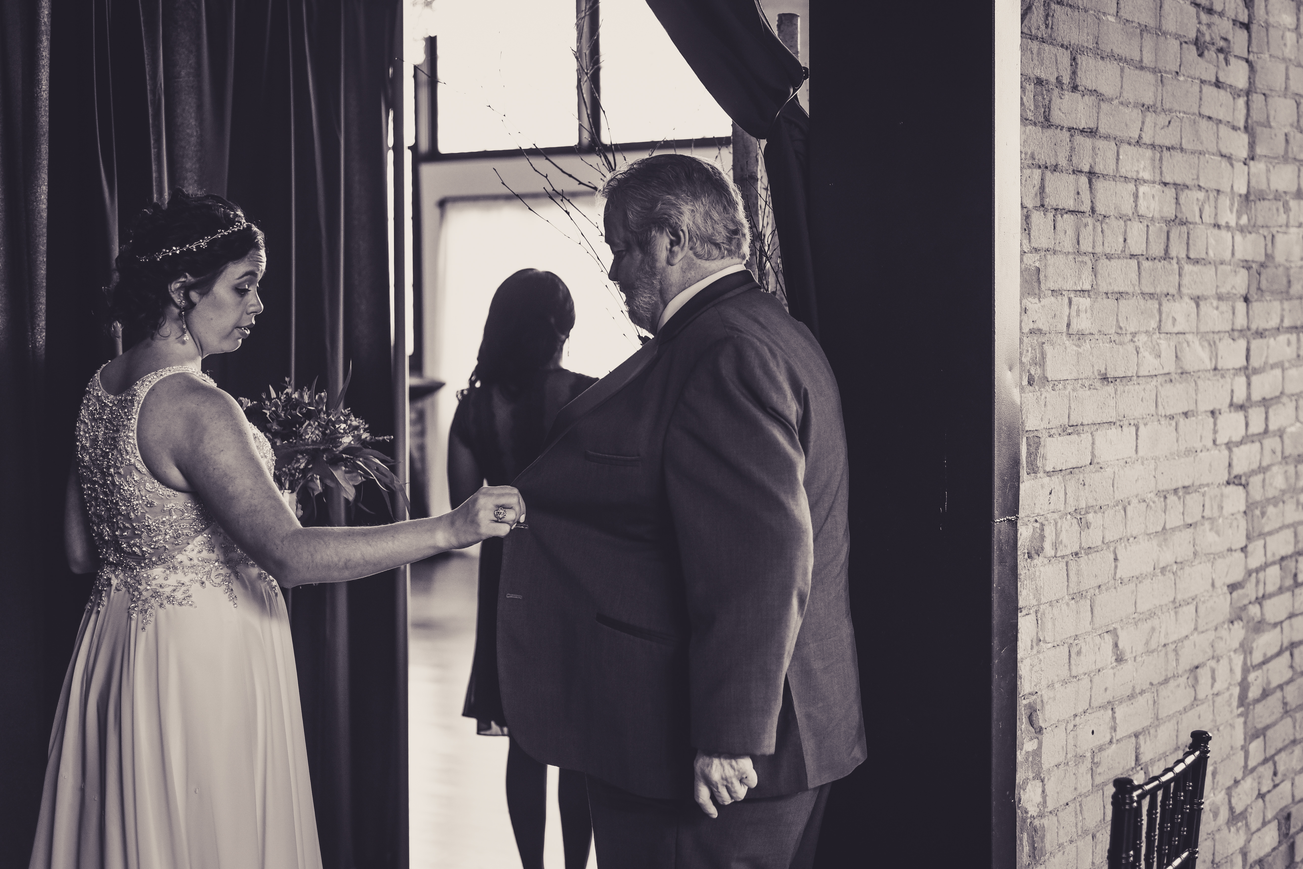 a bride together with her father before her wedding ceremony