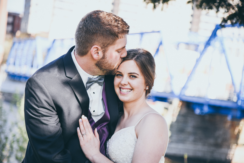 photo of bride and groom hugging in front of the blue bride in grand rapids michigan
