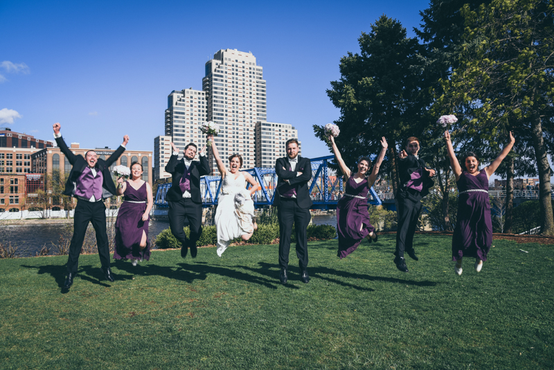 bridal party fun photos at blue bridge in grand rapids michigan