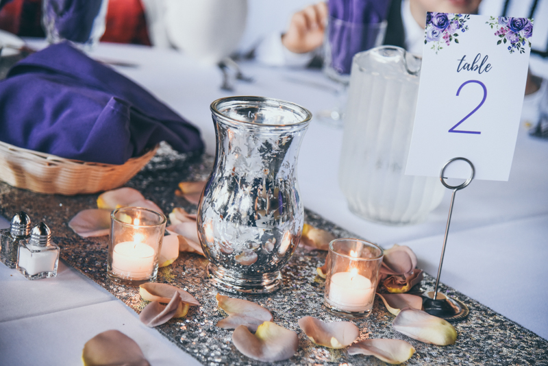 silver sequin tablerunners with silver hurricane vases